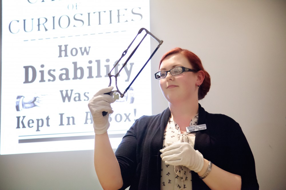 Lauren displays a surgical saw at the Cabinet of Curiosities event (Thackray Medical Museum, Leeds).