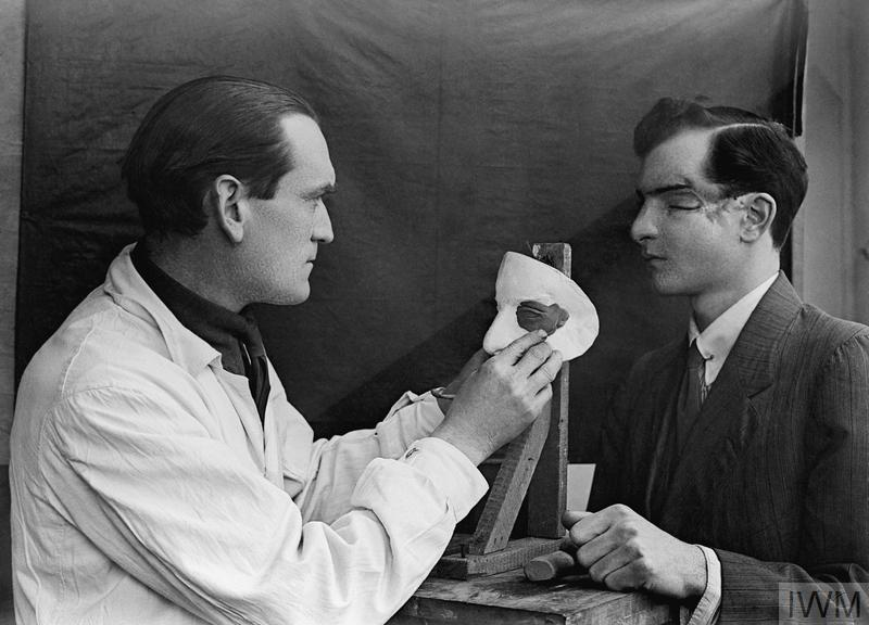 Artist Derwent Wood puts the finishing touches to a cosmetic plate for a facially disfigured patient. 'Tin Faces' were a commonly used prosthetic during WWI for severally disfigured servicemen. Credit: Imperial War Museum (© IWM Q 30456)